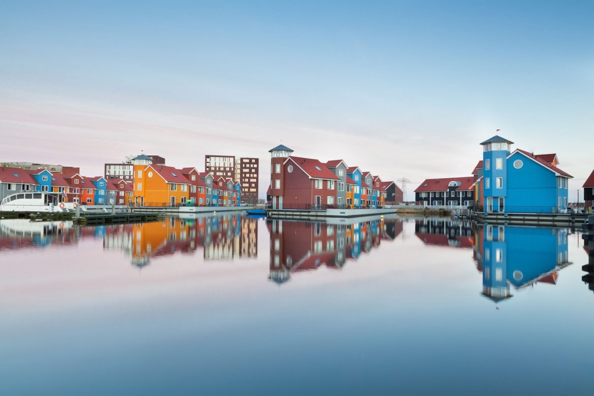 44304132 - colorful buildings on water at haven, groningen, netherlands